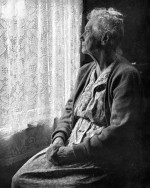 elderly-woman-sitting-looking-out-window-chalmers-butterfield
